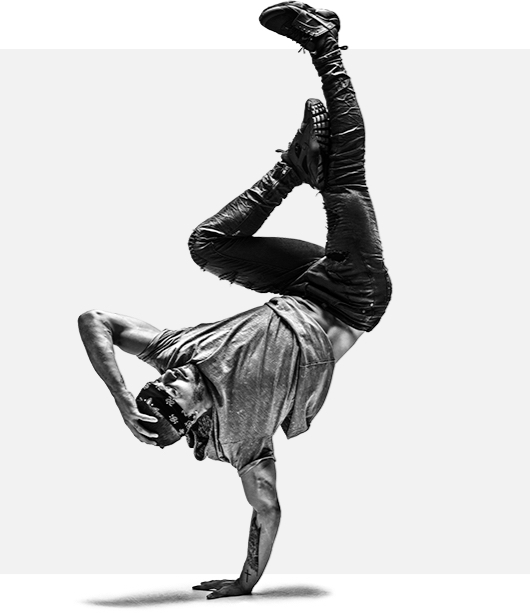 Muscular man with bandana doing a one handed hand stand